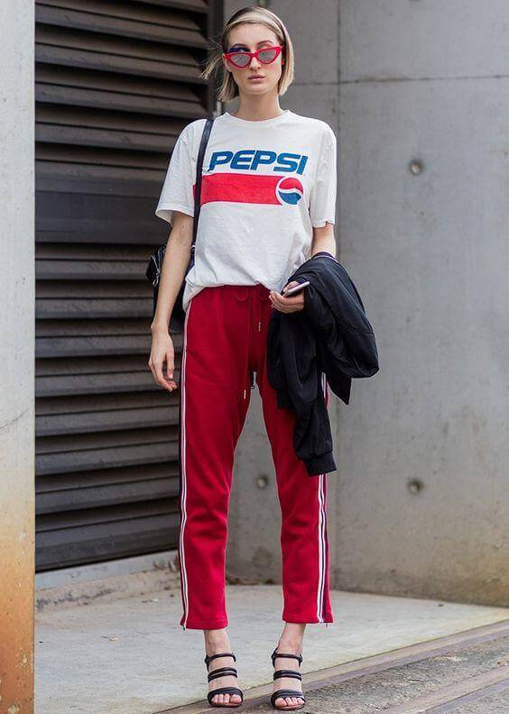 a girl with red Track Pants