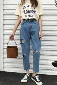 a girl with '90s. Mom jeans