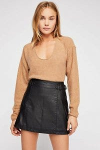 5989a1b74f75 These two leather skirt outfits include a very comfy and casual knit top,  and as you can see, the models have a relaxed hairstyle while barely  wearing ...