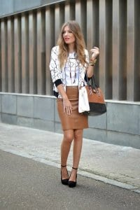 3155ed30d3c0 Another way of making your leather skirt outfit appropriate for work is  half-tucking your top. A knit top, for example, looks super stylish paired  with a ...